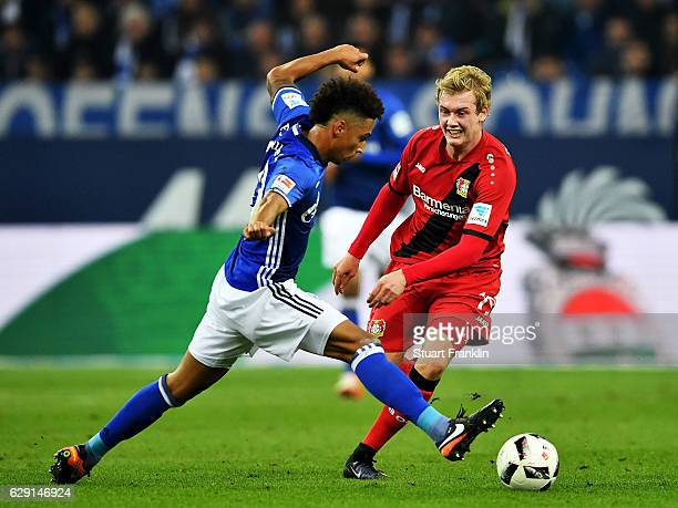 Thilo Kehrer of Schalke battles for the ball with Julian Brandt of Leverkusen during the Bundesliga match between FC Schalke 04 and Bayer 04...