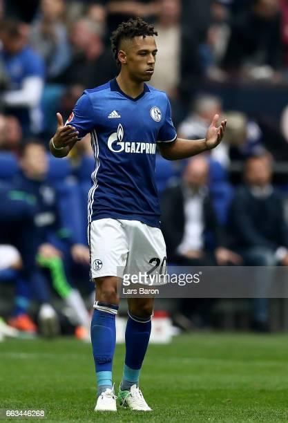 Thilo Kehrer of Schalke celebrates after scoring his teams first goal during the Bundesliga match between FC Schalke 04 and Borussia Dortmund at...