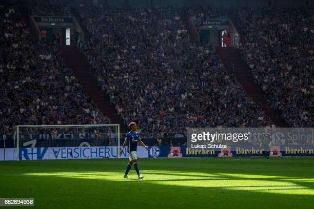 Thilo Kehrer of Schalke is lit by the sunduring the Bundesliga match between FC Schalke 04 and Hamburger SV at VeltinsArena on May 13 2017 in...