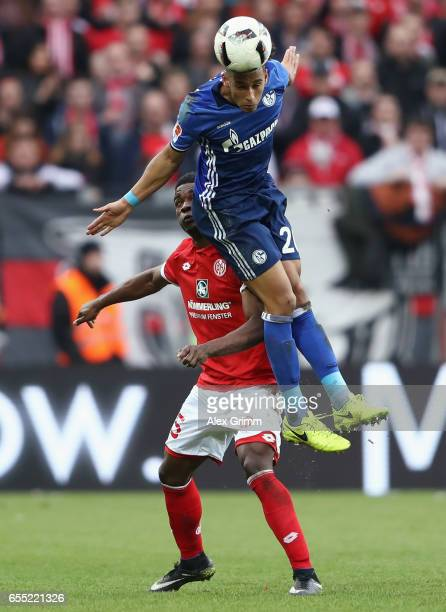 Thilo Kehrer of Schalke outjumps Jhon Cordoba of Mainz during the Bundesliga match between 1 FSV Mainz 05 and FC Schalke 04 at Opel Arena on March 19...