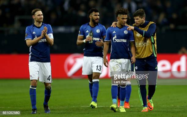 Thilo Kehrer of Schalke speaks with Klaas Jan Huntelaar after the UEFA Europa League Round of 16 first leg match between FC Schalke 04 and Borussia...