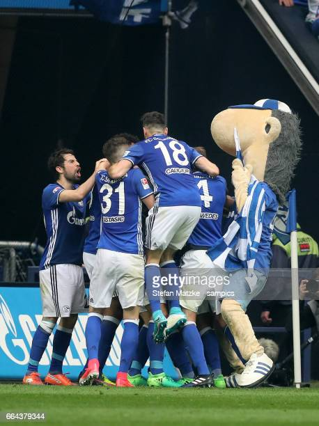 Thilo Kehrer with Maskott Erwin celebrates as he scores the goal 'nduring the Bundesliga match between FC Schalke 04 and Borussia Dortmund at...