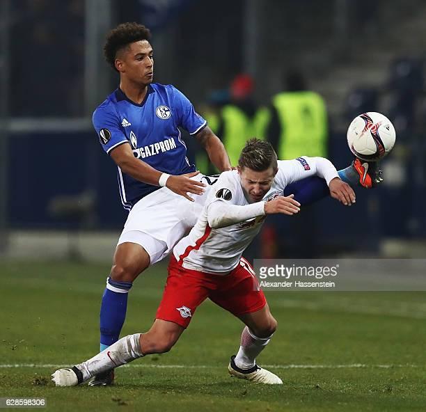 Thilo Kehrerof Schalke is challenged by Mark Rzatkowski of Salzburg during the UEFA Europa League match between FC Salzburg and FC Schalke 04 at Red...