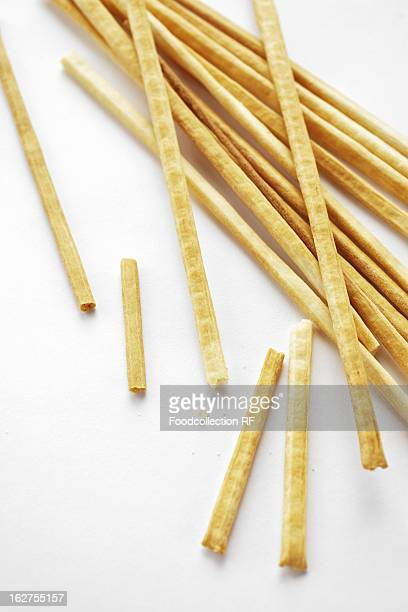 Thin bread stick against white background
