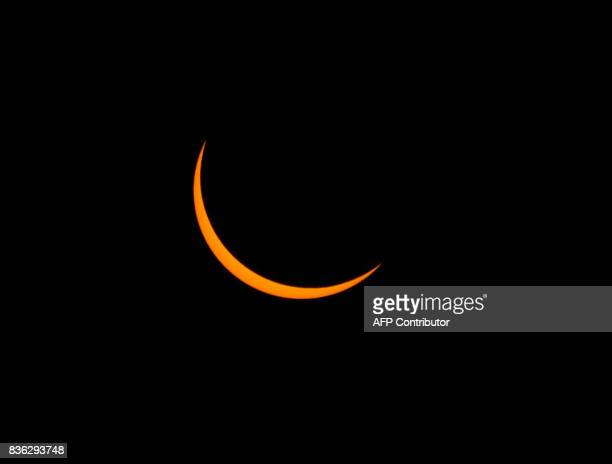 A thin crescent sun is viewed just before totality during a solar eclipse seen from the Lowell Observatory Solar Eclipse Experience on August 21 2017...