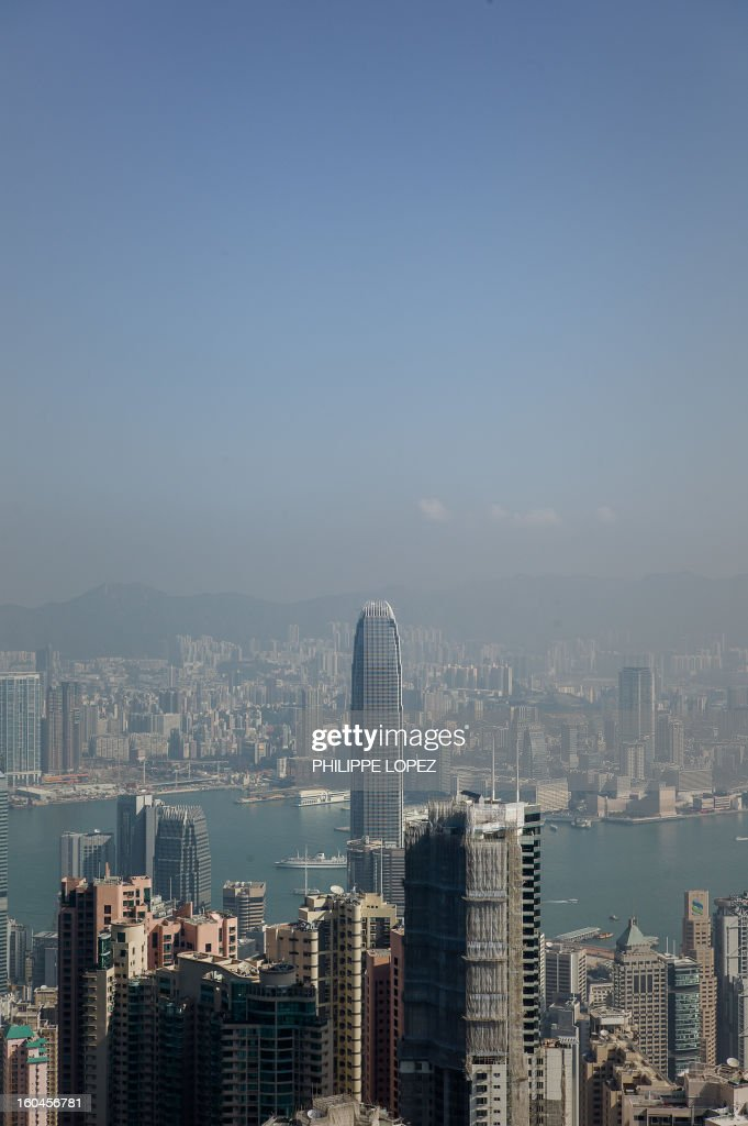 A thin haze of pollution sits over the city's skyline on a clear day in Hong Kong on February 1, 2013. Emissions from factories in southern China, which seep over Hong Kong's border, combined with local emissions from power plants and transport, generate an almost daily thick blanket of haze over the teeming metropolis. AFP PHOTO / Philippe Lopez