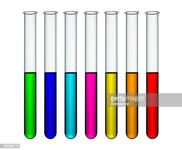 Thin test tubes with rainbow colored liquids