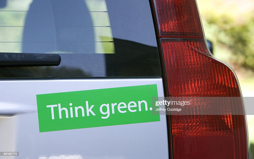 Think green bumper sticker on car