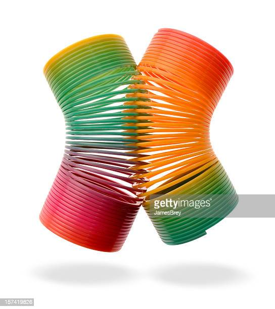 Think Spring! Two Colorful Plastic Springs Intertwined, Floating, White Background