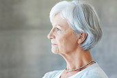 Profile shot of an attractive senior woman looking pensive
