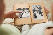 Senior couple at their wedding photos in photo album
