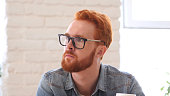 Thinking Pensive Man with Beard and Red Hairs