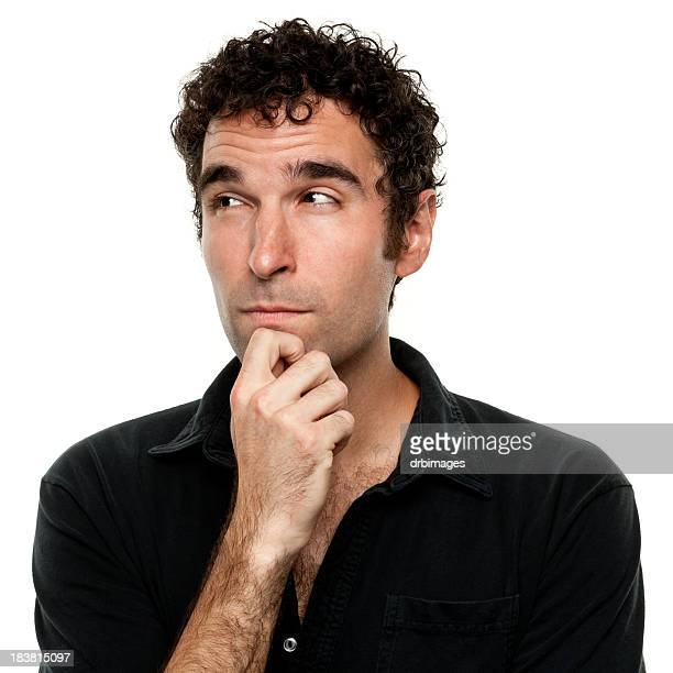 Thinking Young Man With Hand On Chin Looking Away