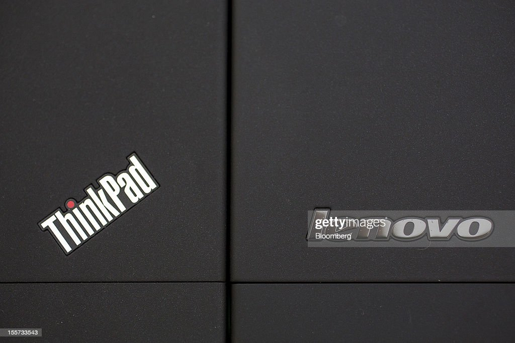 A Thinkpad logo, left, and a Lenovo Group Ltd. logo are displayed on Lenovo Thinkpad laptop computers arranged side by side for a photograph in Hong Kong, China, on Wednesday, Nov. 7, 2012. Lenovo announces second quarter earnings today. Photographer: Jerome Favre/Bloomberg via Getty Images