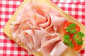 Thinly sliced ham on cutting board