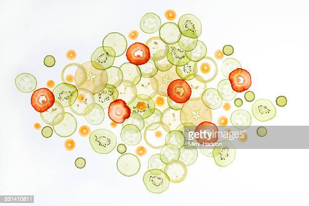 Thinly Sliced Vegetables and Fruits on Light Table