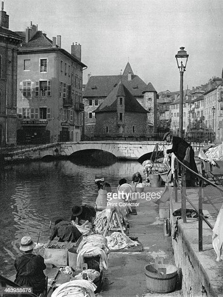 Thiou canal Annecy France 1937 Women doing laundry in the canal with the 12thcentury Palais de l'Isle in the background Illustration from Frankreich...