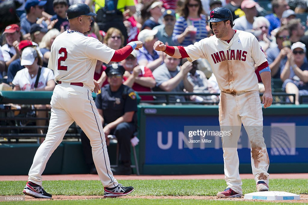 Third base coach Brad Mills #2 celebrates with <a gi-track='captionPersonalityLinkClicked' href=/galleries/search?phrase=Jason+Kipnis&family=editorial&specificpeople=5330784 ng-click='$event.stopPropagation()'>Jason Kipnis</a> #22 of the Cleveland Indians after Kipnis reached third and went on to score during the fourth inning against the Washington Nationals at Progressive Field on June 16, 2013 in Cleveland, Ohio.
