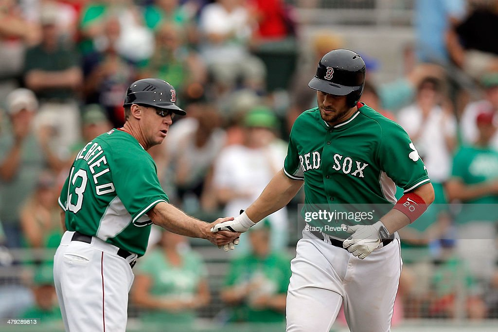 Third base coach Brian Butterfield #13 of the Boston Red Sox congratulates Ryan Lavarnway #20 following an eighth inning home run against the St. Louis Cardinals at JetBlue Park at Fenway South on March 17, 2014 in Fort Myers, Florida.