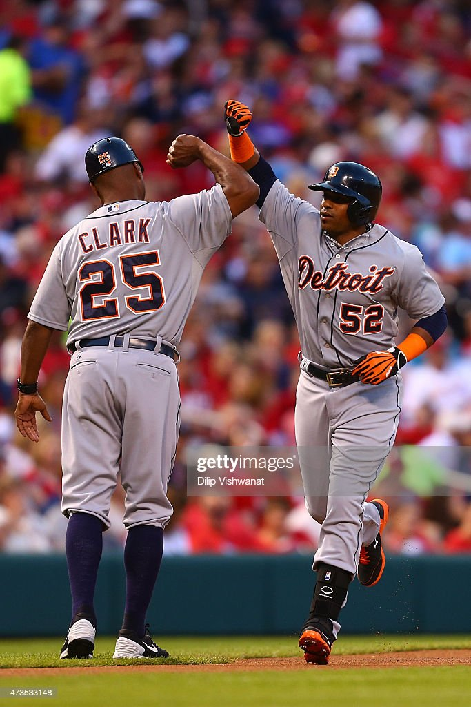 Third base coach Dave Clark #25 of the Detroit Tigers congratulates Yoenis Cespedes #52 of the Detroit Tigers after Cespedes hit a solo home run against the St. Louis Cardinals in the second inning at Busch Stadium on May 15, 2015 in St. Louis, Missouri.