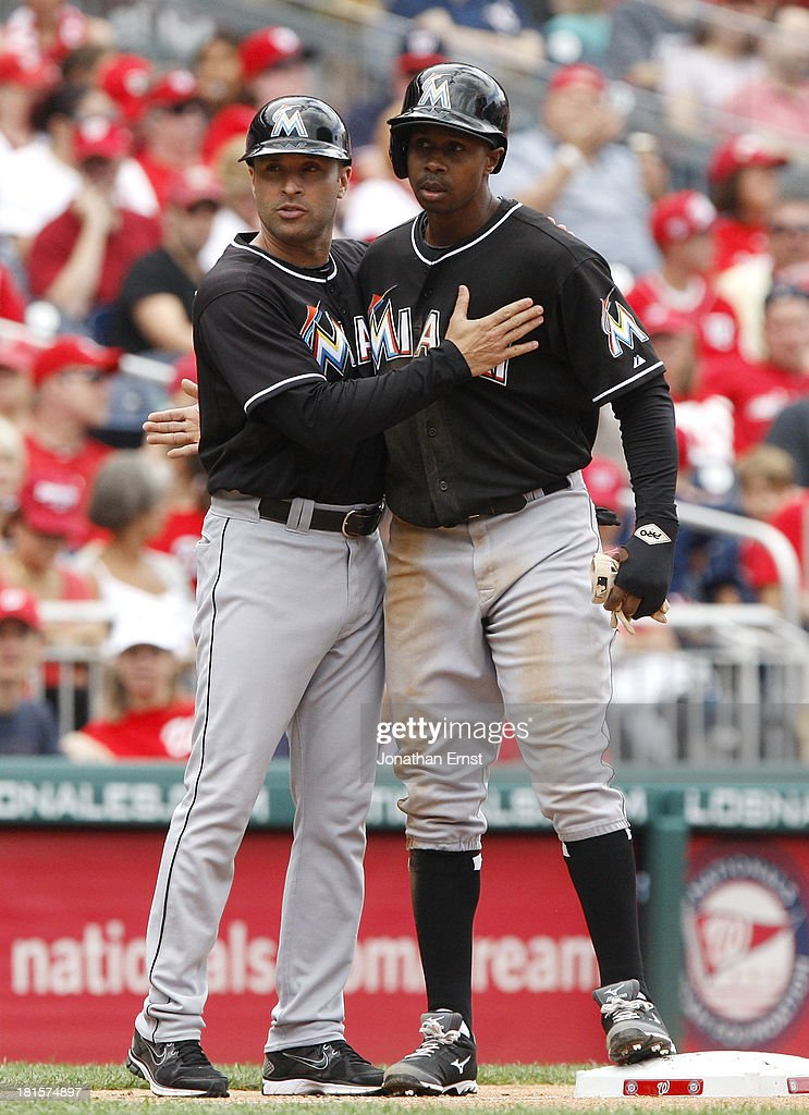 Third base coach Joe Espada (L) of the Miami Marlins greets <a gi-track='captionPersonalityLinkClicked' href=/galleries/search?phrase=Juan+Pierre&family=editorial&specificpeople=202961 ng-click='$event.stopPropagation()'>Juan Pierre</a> #9 (R) at third base after he took third on a wild pitch by pitcher Ryan Mattheus #52 (not pictured) of the Washington Nationals during the seventh inning of game 1 of their day-night doubleheader at Nationals Park on September 22, 2013 in Washington, DC.