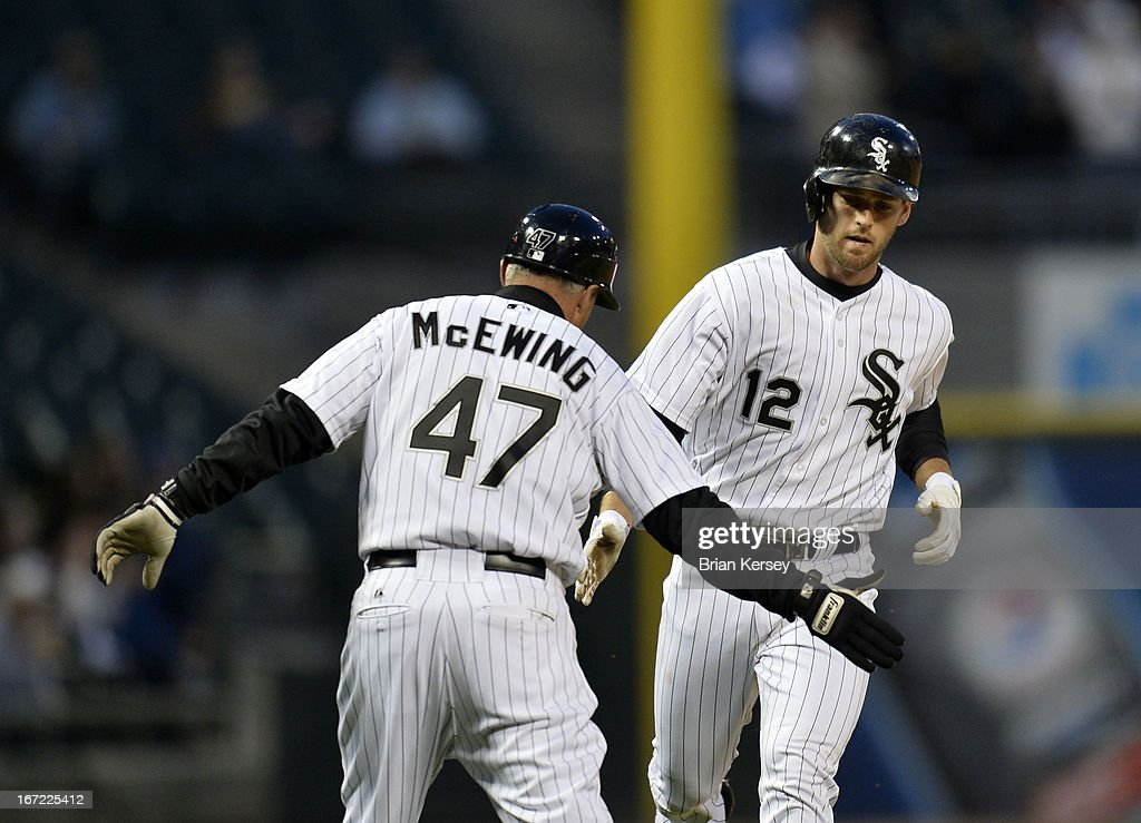 Third base coach <a gi-track='captionPersonalityLinkClicked' href=/galleries/search?phrase=Joe+McEwing&family=editorial&specificpeople=211298 ng-click='$event.stopPropagation()'>Joe McEwing</a> #47 of the Chicago White Sox (L) congratulates Conor Gillaspie #12 as he rounds third base after hitting a solo home run during the second inning against the Cleveland Indians on April 22, 2012 at U.S. Cellular Field in Chicago, Illinois.