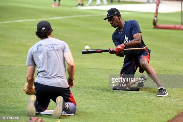 Third base coach Ron Washington of the Atlanta Braves hits short hoppers to Dansby Swanson prior to a game against the Arizona Diamondbacks at Chase...