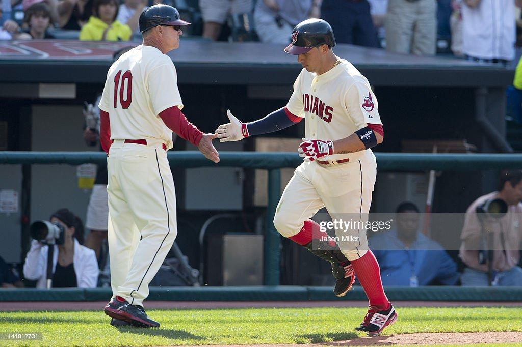 Third base coach Steve Smith #10 celebrates with <a gi-track='captionPersonalityLinkClicked' href=/galleries/search?phrase=Asdrubal+Cabrera&family=editorial&specificpeople=834042 ng-click='$event.stopPropagation()'>Asdrubal Cabrera</a> #13 of the Cleveland Indians as Cabrera makes his way home after hitting a solo home run during the fourth inning against the Miami Marlins at Progressive Field on May 19, 2012 in Cleveland, Ohio.