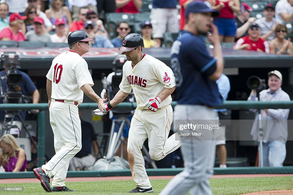 Third base coach third Steve Smith #10 celebrates with <a gi-track='captionPersonalityLinkClicked' href=/galleries/search?phrase=Casey+Kotchman&family=editorial&specificpeople=240573 ng-click='$event.stopPropagation()'>Casey Kotchman</a> #35 of the Cleveland Indians after Kotchman hit a solo home run off starting pitcher James Shields #33 of the Tampa Bay Rays during the fourth inning at Progressive Field on July 8, 2012 in Cleveland, Ohio.