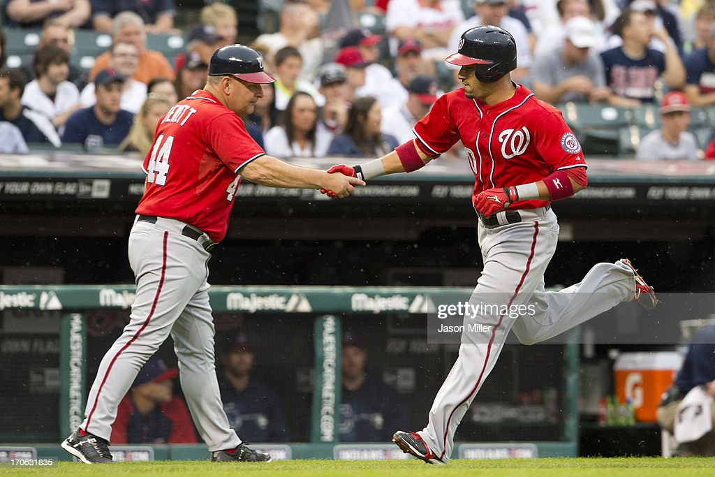 Third base coach Trent Jewett #44 celebrates with <a gi-track='captionPersonalityLinkClicked' href=/galleries/search?phrase=Ian+Desmond&family=editorial&specificpeople=835572 ng-click='$event.stopPropagation()'>Ian Desmond</a> #20 of the Washington Nationals as he rounds the bases after hitting a solo home run during the second inning against the Cleveland Indians at Progressive Field on June 15, 2013 in Cleveland, Ohio.