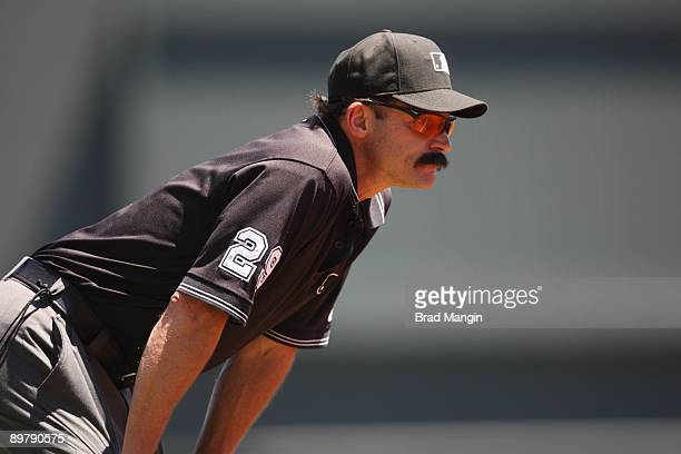 Third base umpire Bill Hohn works the game between the Los Angeles Dodgers and the San Francisco Giants at ATT Park in San Francisco California on...
