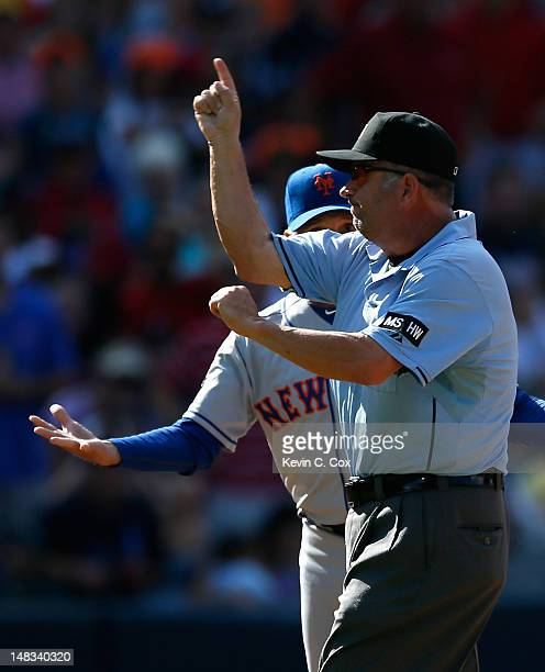 Third base umpire Dale Scott ejects Terry Collins of the New York Mets in the fifth inning by for arguing a call against the Atlanta Braves at Turner...