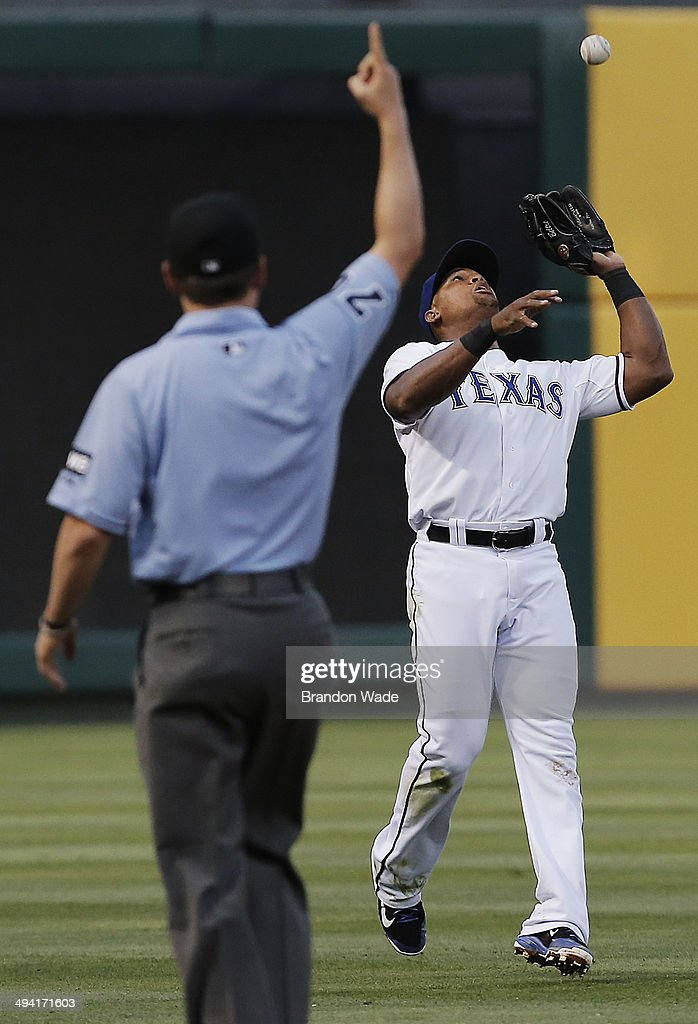 Third base umpire DJ Reyburn signals the infield fly rule as third baseman Adrian Beltre of the Texas Rangers catches a hit by James Jones of the...