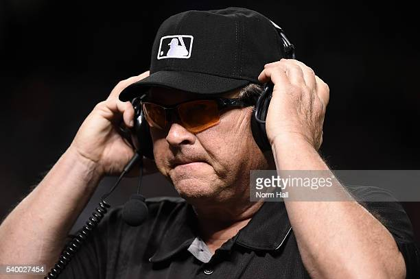 Third base umpire Gerry Davis listens on the headset for a review on a home run by Paul Goldschmidt of the Arizona Diamondbacks during the seventh...
