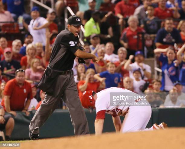 Third base umpire Jim Reynolds calls out the St Louis Cardinals' Jedd Gyorko who was trying to take two bases on a single by Paul DeJong in the third...
