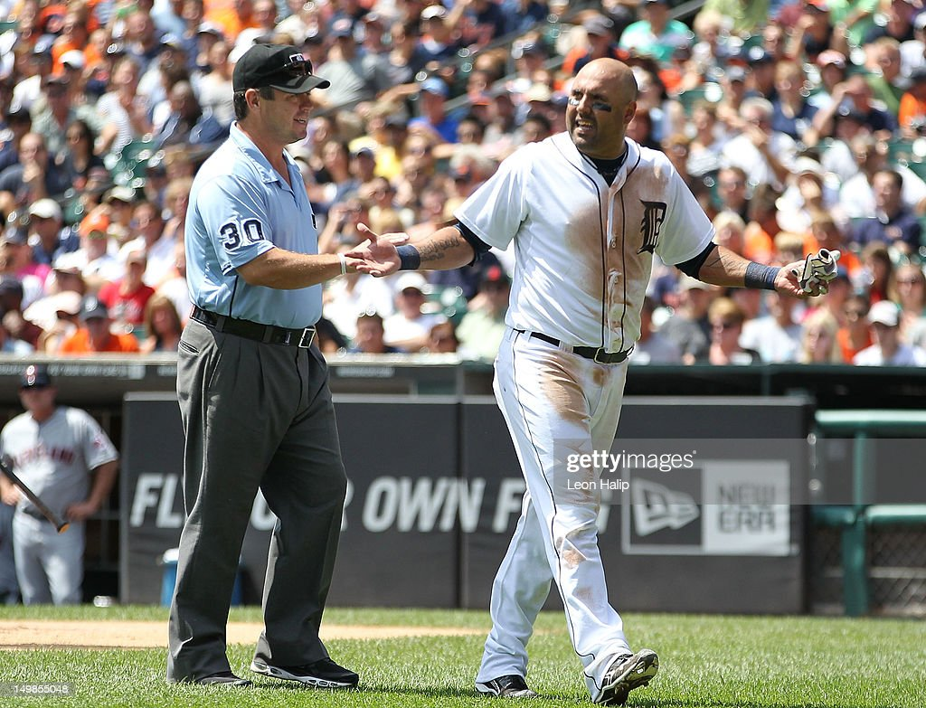 Third base umpire <a gi-track='captionPersonalityLinkClicked' href=/galleries/search?phrase=Rob+Drake&family=editorial&specificpeople=247242 ng-click='$event.stopPropagation()'>Rob Drake</a> talks with <a gi-track='captionPersonalityLinkClicked' href=/galleries/search?phrase=Gerald+Laird&family=editorial&specificpeople=228949 ng-click='$event.stopPropagation()'>Gerald Laird</a> #9 after first base umpire Sam Holbrook ejected Laird from the game during the second inning of the game gainst the Cleveland Indians at Comerica Park on August 5, 2012 in Detroit, Michigan.