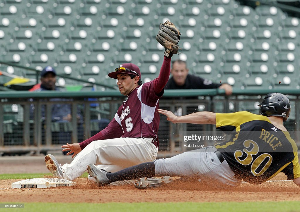Third baseman Adrian Lopez #5 of TSU slides into third base to force out Dexter Price #30 of Alabama State during the 2013 Urban Invitational, February 24, 2013 in Houston, Texas.