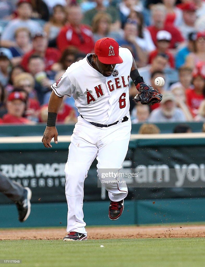 Third baseman Alberto Callaspo #6 of the Los Angeles Angels of Anaheim commits an error as he can't come up with a ground ball hit by Starling Marte of the Pittsburgh Pirates in the second inning at Angel Stadium of Anaheim on June 22, 2013 in Anaheim, California.