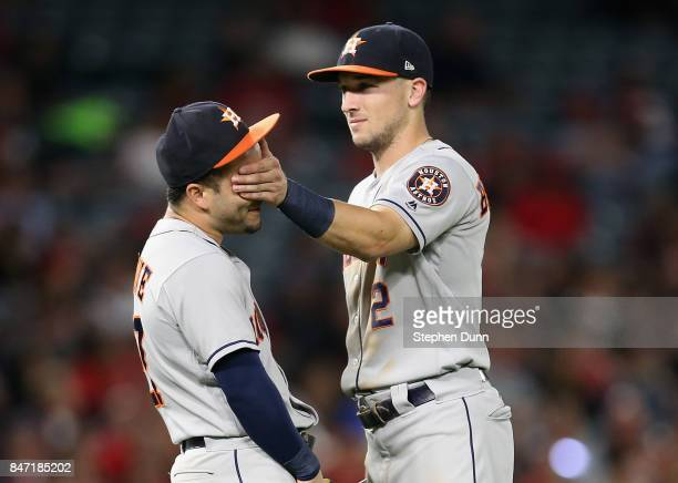 Third baseman Alex Bregman of the Houston Astros covers the eyes of second baseman Jose Altuve as they have playful moment during a pitching change...