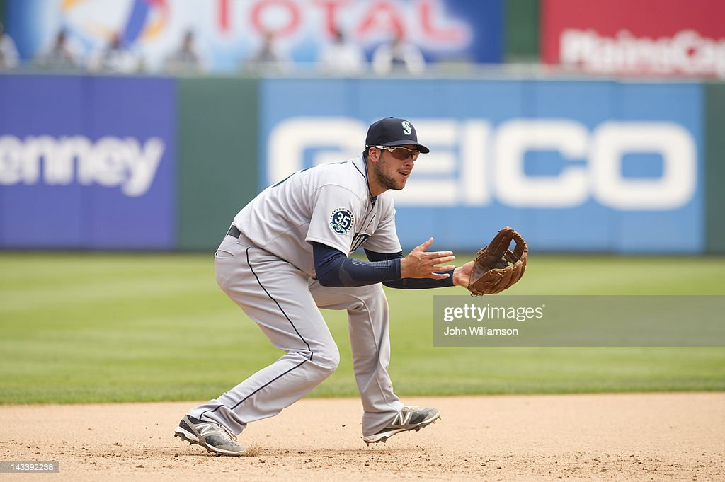 Third baseman <a gi-track='captionPersonalityLinkClicked' href=/galleries/search?phrase=Alex+Liddi&family=editorial&specificpeople=5751736 ng-click='$event.stopPropagation()'>Alex Liddi</a> #16 of the Seattle Mariners fields his position as he reacts to and moves in front of a ground ball in the game against the Texas Rangers on Thursday, April 12, 2012 at Rangers Ballpark in Arlington in Arlington, Texas. The Texas Rangers defeated the Seattle Mariners 5-3.