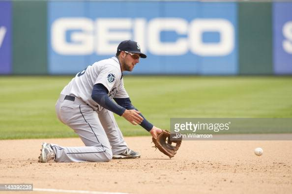 Third baseman Alex Liddi of the Seattle Mariners fields his position as he catches a ground ball in the game against the Texas Rangers on Thursday...