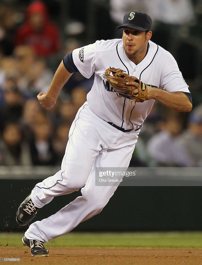 Third baseman <a gi-track='captionPersonalityLinkClicked' href=/galleries/search?phrase=Alex+Liddi&family=editorial&specificpeople=5751736 ng-click='$event.stopPropagation()'>Alex Liddi</a> #16 of the Seattle Mariners follows a ground ball single by <a gi-track='captionPersonalityLinkClicked' href=/galleries/search?phrase=Brandon+Allen+-+Baseball+Player&family=editorial&specificpeople=2238262 ng-click='$event.stopPropagation()'>Brandon Allen</a> of the Oakland Athletics at Safeco Field on September 27, 2011 in Seattle, Washington.