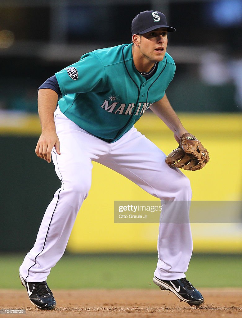 Third baseman Alex Liddi of the Seattle Mariners watches the pitch during the game against the Kansas City Royals at Safeco Field on September 9 2011...