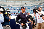 Third baseman Alex Rodriguez of the New York Yankees exits the dugout and runs onto the field to participate in a spring training workout on February...