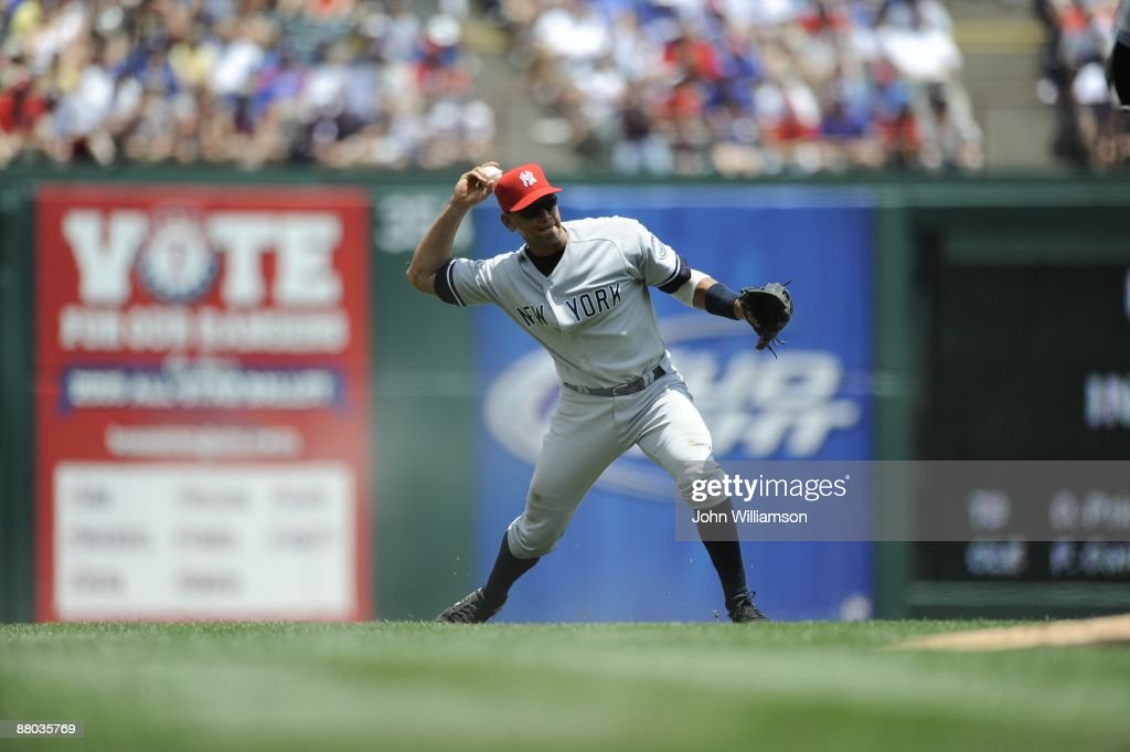 Third baseman Alex Rodriguez of the New York Yankees fields his position as he throws to first base after catching a ground ball during the game...