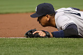 Third baseman Alex Rodriguez of the New York Yankees follows the ball after missing a single hit by Adam Jones of the Baltimore Orioles for a single...