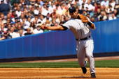 Third baseman Alex Rodriguez of the New York Yankees throws to first against the Kansas City Royals during the home opener at Yankee Stadium on April...
