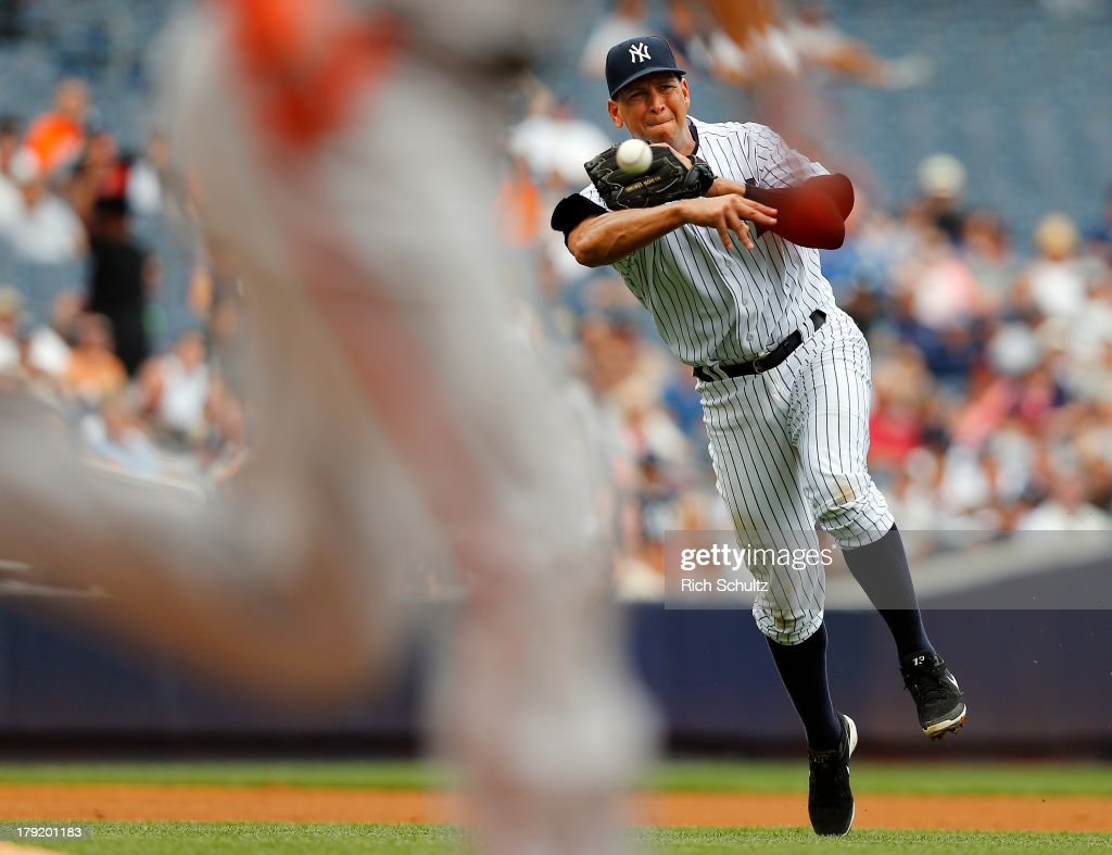 Third baseman Alex Rodriguez #13 throws to first base but <a gi-track='captionPersonalityLinkClicked' href=/galleries/search?phrase=Danny+Valencia&family=editorial&specificpeople=5443820 ng-click='$event.stopPropagation()'>Danny Valencia</a> #35 of the Baltimore Orioles beats it out for a single during the fourth inning in a MLB baseball game at Yankee Stadium on September 1, 2013 in the Bronx borough of New York City.