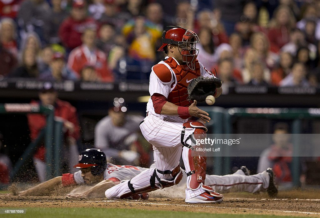 Third baseman Anthony Rendon #6 of the Washington Nationals beats the throw to catcher Carlos Ruiz #51 of the Philadelphia Phillies and scores the go ahead run in the eighth inning on May 2, 2014 at Citizens Bank Park in Philadelphia, Pennsylvania.