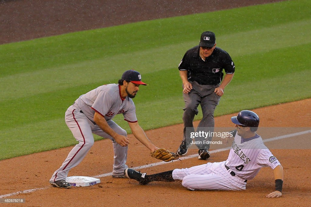 Third baseman <a gi-track='captionPersonalityLinkClicked' href=/galleries/search?phrase=Anthony+Rendon&family=editorial&specificpeople=7539238 ng-click='$event.stopPropagation()'>Anthony Rendon</a> #6 of the Washington Nationals tags out Ben Paulsen #4 of the Colorado Rockies while trying to advance to third base for the second out of the seventh inning at Coors Field on July 23, 2014 in Denver, Colorado. The Rockies defeated the Nationals 6-4.